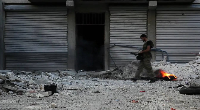 Free_Syrian_Army_soldier_walking_among_rubble_in_Aleppo 2014