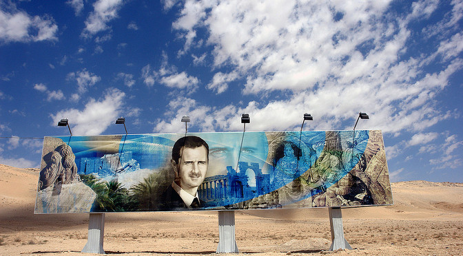 Roadside mural of Bashar al Assad along the Damascus-Aleppo highway 1 by James Gordon from Los Angeles, California, USA, CC-BY-2.0 , via Wikimedia Commons