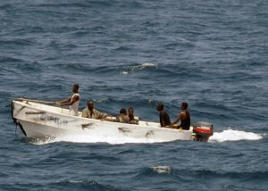 Pirates_leave_the_merchant_vessel_MV_Faina_for_the_Somali_shore_Wednesday,_Oct._8,_2008_while_under_observation_by_a_U.S._Navy_ship