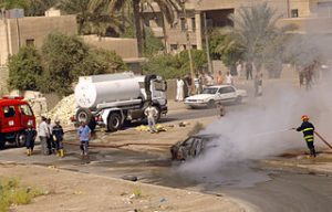 320px-US_Navy_060808-N-7590D-055_Iraqi_firefighters_extinguish_a_vehicle_fire_in_Baghdad_after_it_was_hit_by_a_mortar_that_was_fired_by_insurgents