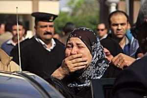 Grieving_friends_and_relatives_gather_outside_the_Agouza_Police_Hosptial_after_a_series_of_explosions_at_Cairo_University_left_many_dead_or_wounded_-_Cairo_2-Apr-2014