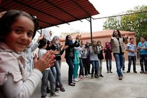 Singing_helps_ease_the_memories_of_conflict_for_Syrian_children_in_Lebanon_(11173659465)