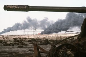 320px-Disabled_Iraqi_T-54A,_T-55,_Type_59_or_Type_69_tank_and_burning_Kuwaiti_oil_field
