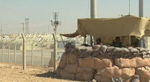 320px-Syrian_refugee_center_with_soldiers_protecting
