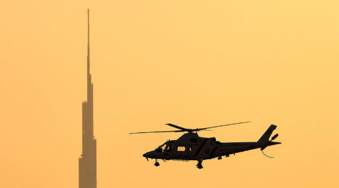 Dubai_Police_Agusta_A-109K-2_in_flight_at_sunset 2014